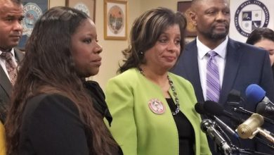 Dawn and Rick Collins, parents of slain 2nd Lt. Richard Collins III, stand alongside Prince George's County State's Attorney Aisha Braveboy (left) at a Feb. 11 press conference in Annapolis. (William J. Ford/The Washington Informer)