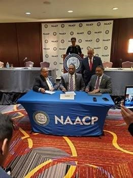 Leon Russell, NAACP chair; Donnell Williams, NAREB president; Derrick Johnson, NAACP president and CEO; and Antoine Thompson, NAREB executive director, gather for the signing of the MOU between both organizations.