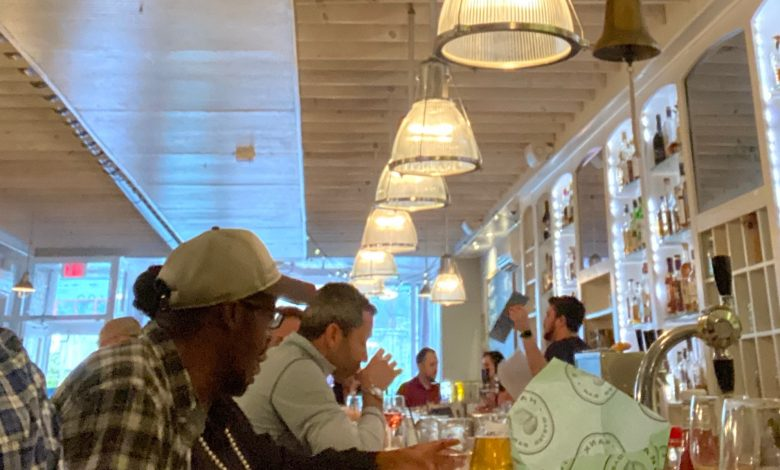 At Hanks Oyster Bar on Capitol Hill, patrons enjoy Happy Hour the day before D.C. Mayor Muriel Bowser issued an order suspending the use of restaurant bar seating and service to standing patrons in an effort to stop the spread of COVID-19. (DR Barnes/The Washington Informer)