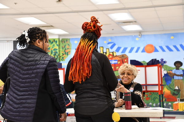 A mother accompanies her daughter who voted for the first time on Super Tuesday at the Charles Drew Community Center in Arlington, Va. (Anthony Tilghman/The Washington Informer)