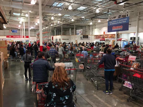 A Virginia Costco store shows packed lines as consumers rush to shop for supplies. (Anthony Tilghman/The Washington Informer)