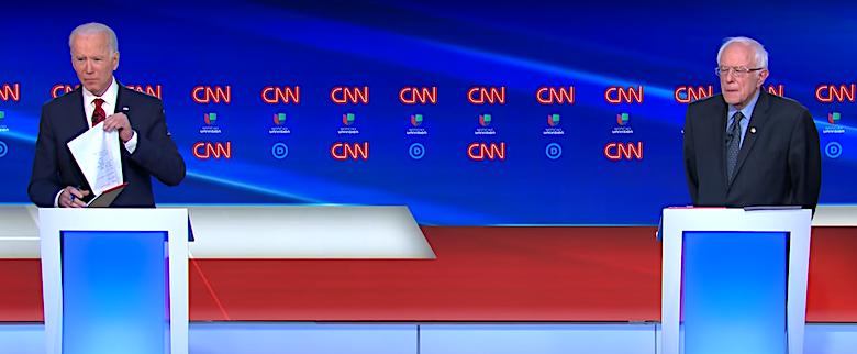 Democratic presidential hopefuls Joe Biden (left) and Bernie Sanders participate in a candidate debate at CNN studios in Washington, D.C., on March 15.