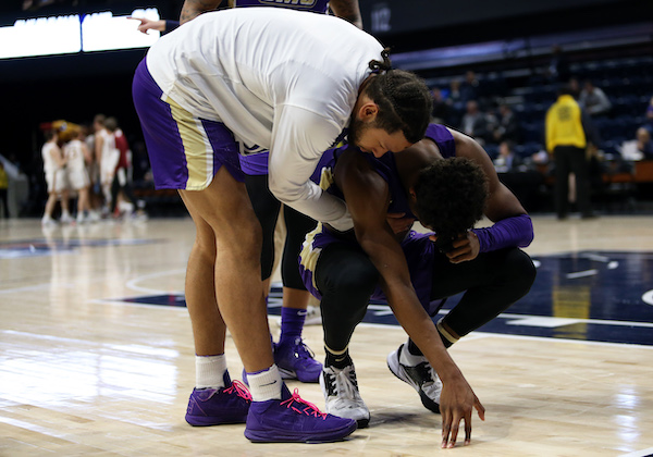 James Madison University players react to losing in the first round of the 2020 CAA tournament after falling to Elon University 63-61 on March 7. (Daniel Kucin Jr./The Washington Informer)