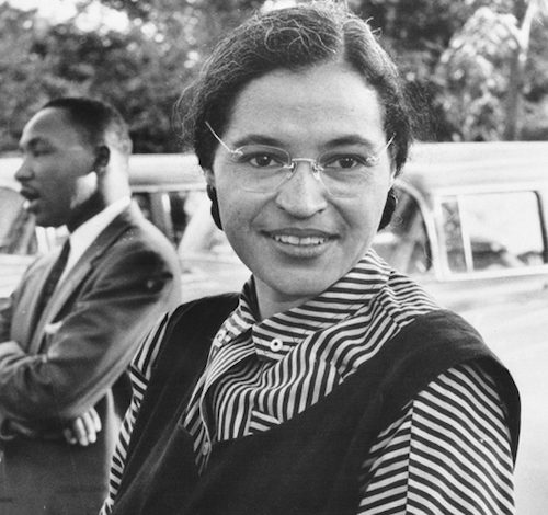 Rosa Parks, seen here circa 1955 with Dr. Martin Luther King Jr. in the background (National Archives)