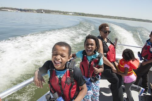 The Anacostia Community Museum's Museum Academy Program explores the Washington Channel and the Anacostia River aboard the Chesapeake Bay Foundation boat, The Susquehanna,2014 (Photograph by Susana Raab, Anacostia Community Museum Archives, Smithsonian Institution)
