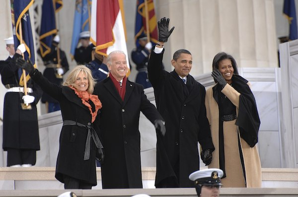 **FILE** Jill Biden, left, Vice President-elect Joe Biden, President-elect Barack Obama, and Michelle Obama wave to the crowd gathered at the Lincoln Memorial on the National Mall in Washington during the Inaugural opening ceremonies. More than 5,000 men and women in uniform are providing military ceremonial support to the 2009 Presidential Inauguration, a tradition dating back to George Washington's 1789 Inauguration. (U.S. Navy photo by Mass Communication Specialist 2nd Class George Trian/Released)