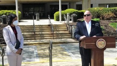 Maryland Gov. Larry Hogan speaks during an April 22 press conference outside Laurel Medical Center to announce the facility will reopen to treat coronavirus patients as Prince George's County Executive Angela Alsobrooks looks on. (William J. Ford/The Washington Informer)