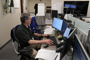Roland Berg, training and exercise officer for Prince George's County's Office of Emergency Management, works inside the control room at the county's Emergency Operations Center in Landover. (Roy Lewis/The Washington Informer)