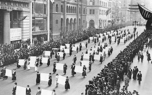 Women's suffragists parade in New York City in 1917, carrying placards with the signatures of more than a million women (The New York Times Photo Archive via Wikimedia Commons)