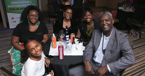 NNPA Senior Correspondent Stacy M. Brown (right), wife Shenay (third from left) and family (Courtesy of NNPA Newswire)