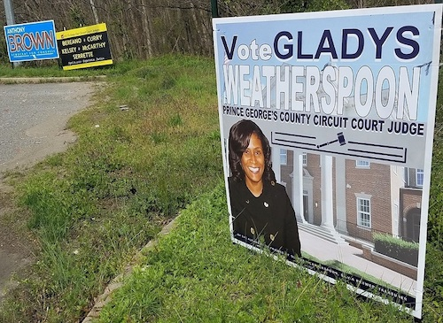 A yard sign for Gladys Weatherspoon, a candidate for Prince George's County Circuit Court judge, along Route 202 near White House Road in Upper Marlboro is shown here on April 5. The sign with black background in the center shows the five incumbent judges running as a slate. (William J. Ford/The Washington Informer)