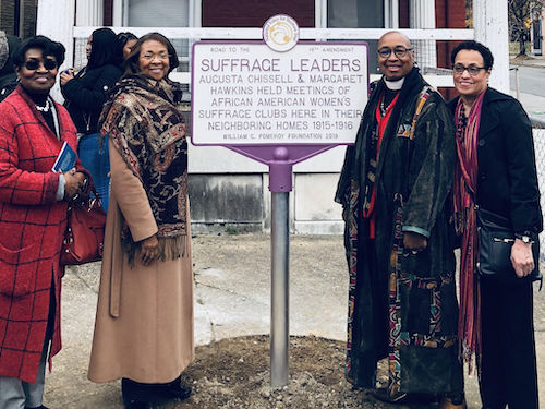 From left: DuBois Circle members Evelyn McClarry, Judith Smith, group President Sandye A. Wilson and Beverly Carter celebrate the unveiling of a marker honoring Baltimore suffragists on Druid Hill Avenue. (Jean Thompson via The AFRO)