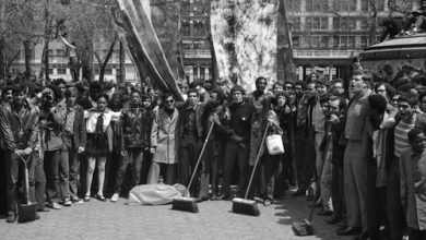 """Earth Day celebrations in Union Square Park included clean up crews composed of school children. Con Edison, often criticized for their environmental policies, donated brooms, mops and other supplied for the cause. Other events in the park included Frisbee games and a massive plastic bubble filled with """"fresh air."""" (Courtesy of the Archives of New York City)"""
