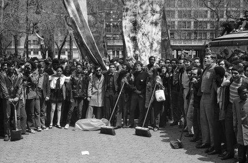 "Earth Day celebrations in Union Square Park included clean up crews composed of school children. Con Edison, often criticized for their environmental policies, donated brooms, mops and other supplied for the cause. Other events in the park included Frisbee games and a massive plastic bubble filled with ""fresh air."" (Courtesy of the Archives of New York City)"