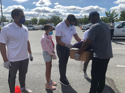 Members of Kingdom Fellowship AME Church distribute groceries during a May 16 event to help those in need during the coronavirus pandemic. (Courtesy of Kingdom Fellowship AME Church)