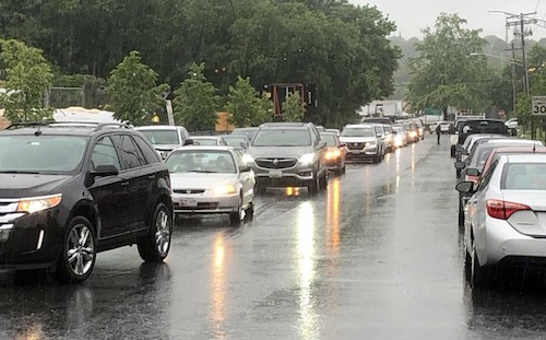 Motorists await free coronavirus testing at the Vehicle Emissions Inspection Station in Hyattsville, Maryland, on May 22, the first day of testing at the location. (Anthony Tilghman/The Washington Informer)