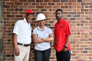 From left: Linwood Williams, owner of Lendana Construction Co., his wife Ardania Willilams and their son, Linwood P. Williams Jr. (Anthony Tilghman/The Washington Informer)