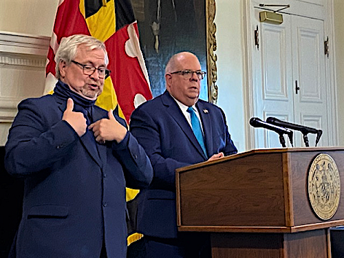 Maryland Gov. Larry Hogan (right) speaks during a May 13 press conference in Annapolis to announce his lifting of a statewide stay-at-home order amid the coronavirus pandemic. (William J. Ford/The Washington Informer)