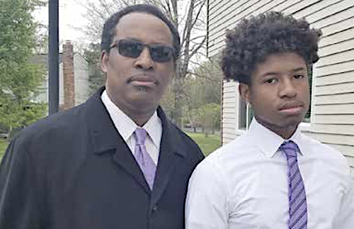 William J. Ford and son Jabari outside their home on April 12 (Courtesy photo)