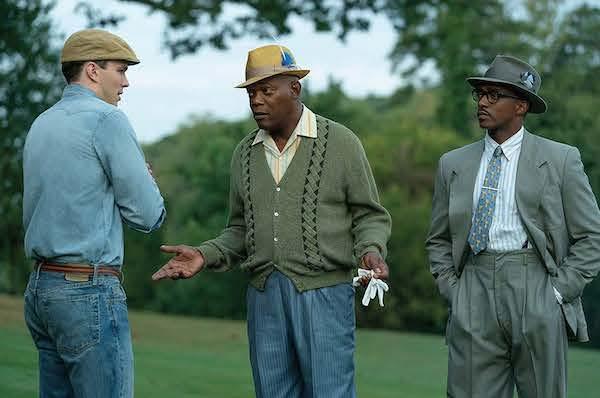 "Samuel L. Jackson (center) leads a star-studded cast in ""The Banker."" (Courtesy of Apple TV)"