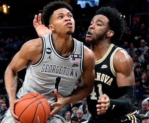**FILE** Georgetown guard Jamorko Pickett is pressured by Villanova forward Saddiq Bey during Villanova's 70-69 win at Capital One Arena in northwest D.C. on March 7. (John E.. De Freitas/The Washington Informer)