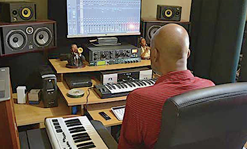 Irvin Lee, The Undiscovered Artist, composes music at his computer. (Courtesy of Irvin Lee)