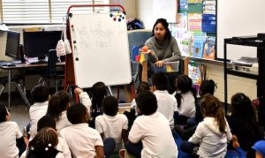**FILE** Brenda Aguilar, a kindergarten teacher at William Beanes Elementary School in Suitland, Maryland, works with students on Jan. 30. (Anthony Tilghman/The Washington Informer)