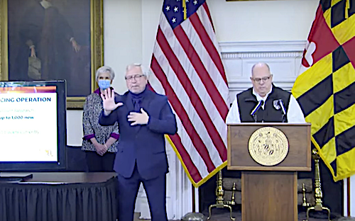 Maryland Gov. Larry Hogan (at lectern) speaks during a May 6 press conference updating the state's response to the ongoing coronavirus pandemic.