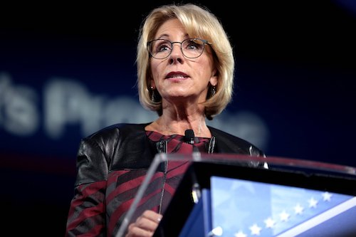 Education Secretary Betsy DeVos has rolled back civil rights protections for college students filing complaints of sexual harassment or assault. (Courtesy of globalcitizen.com)
