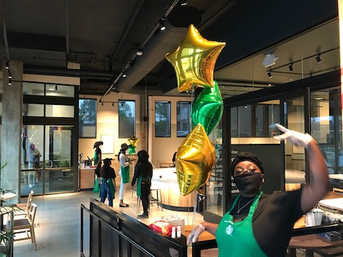 Baristas and staffers welcome customers to the new Starbucks in the Anacostia neighborhood of southeast D.C. (John Muller/Special to The Informer)