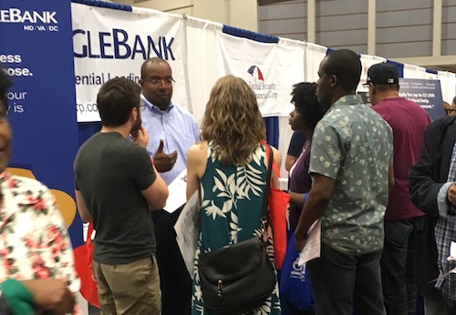 Maceo Clark talks with attendees of the 2019 DC Housing Expo. (Courtesy photo)