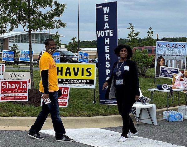 Prince George's County Circuit Court judge candidate Gladys Weatherspoon (right) and school board member Bryan Swann outside Kentland Community Center in Landover during the county's June 2 presidential primary election (William J. Ford/The Washington Informer)