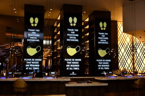Huge signs at the MGM National Harbor remind patrons of its requirements for masks and social distancing as the casino resort reopens amid the coronavirus pandemic. (Anthony Tilghman/The Washington Informer)