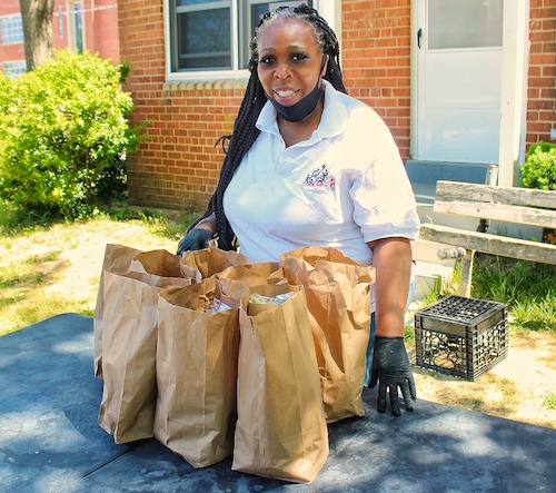 Julia Tutt, resident council president at Highland Additions, prepares to feed those in need in the neighborhood each day from noon to 2 p.m. (Brigette Squire/The Washington Informer)