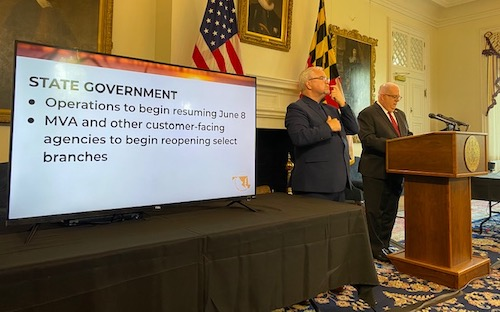 Maryland Gov. Larry Hogan (right) speaks during a June 3 press conference in Annapolis to announce that the state will allow nonessential businesses to reopen this week amid the coronavirus pandemic. (William J. Ford/The Washington Informer)