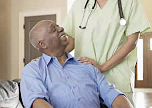 An elderly gentleman with a caregiver in a nursing home (Courtesy photo/stock)