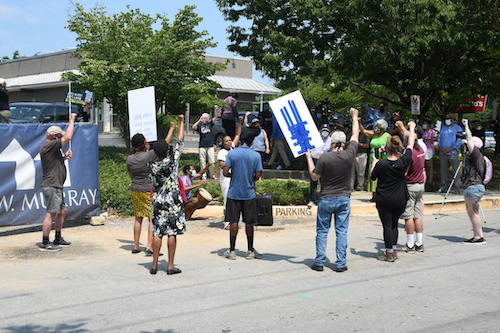 Demonstrators gather near the presumed site of the Moses Cemetery in Bethesda, Maryland, to protest construction on sacred land. (Roy Lewis/The Washington Informer)
