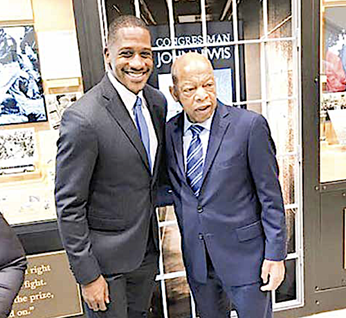 Chief of Staff Michael Collins with Rep. John Lewis (Courtesy of Collins via Facebook)