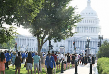 Several thousand people stand in lines extending several blocks to say final farewells to Rep. John Lewis, who lay in state in the Rotunda of the Capitol on July 27 and 28. (Roy Lewis/The Washington Informer)