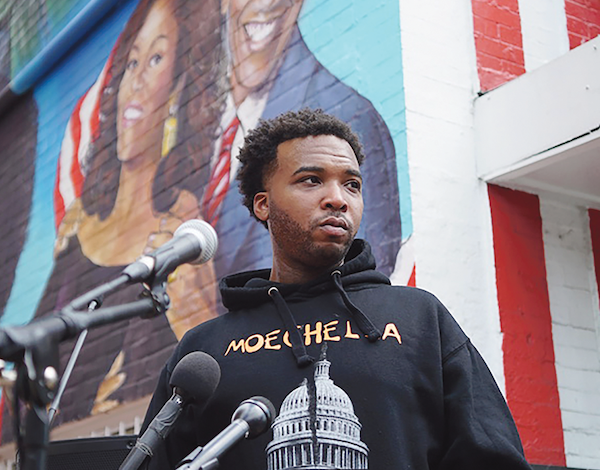 "Justin ""Yaddiya"" Johnson prepares to address the people at Ben's Chili Bowl on U Street NW in D.C. (Photo by Lafayette Barnes IV)"