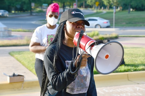 Kiah Minor gives emotional testimony about her father, Michael Ricardo Minor, who was fatally shot by Prince George's County Police in October 2014, at a rally in Bowie on July 1. (Anthony Tilghman/The Washington Informer)
