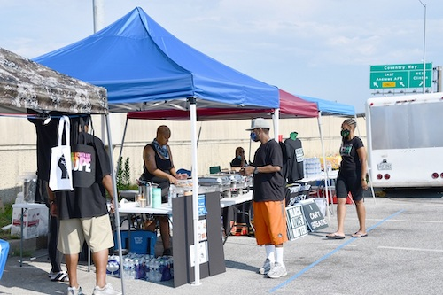 Black vendors showcase their products in a parking lot near Planet Fitness and across the street from The Fish Market in Clinton on July 4. (Anthony Tilghman/The Washington Informer)