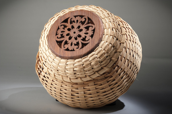 This woven reed basket with carved wood decoration won the First Place Blue Premium Ribbon at the Calvert County Fair, Md. The combination of techniques and materials is a hallmark of artist Ira Blount's work. (Smithsonian Anacostia Community Museum, gift of Ira Blount)