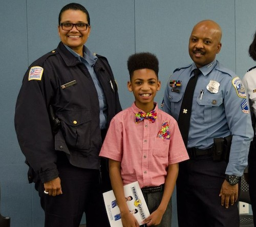 "Miguel Coppedge (center) and MPD Officers Natali Thomas and Kip Coleman, whose friends and helped to inspire the story ""Friendly Officers"" by Coppedge. (Photo by Yolanda Coppedge)"