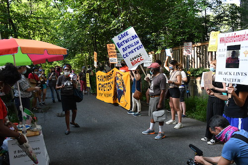Protesters march in Takoma Park on July 10 to condemn construction of a storage facility on the Moses African Cemetery in Bethesda. (Roy Lewis/The Washington Informer)