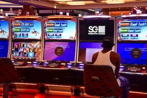 A patron plays a slot machine game at MGM National Harbor in Oxon Hill, Maryland, on June 29. (Anthony Tilghman/The Washington Informer)