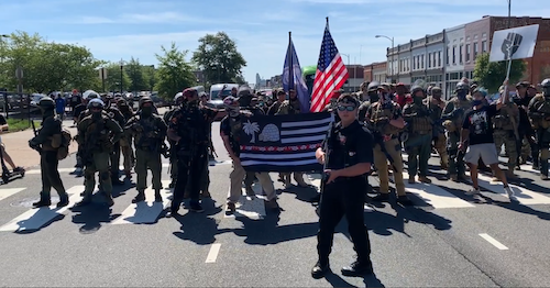 In a screen grab of a video posted by the Richmond Times-Dispatch, demonstrators protesting for gun rights march outside the Science Museum of Virginia in Richmond as state lawmakers hold a special session of the General Assembly on Aug. 18.