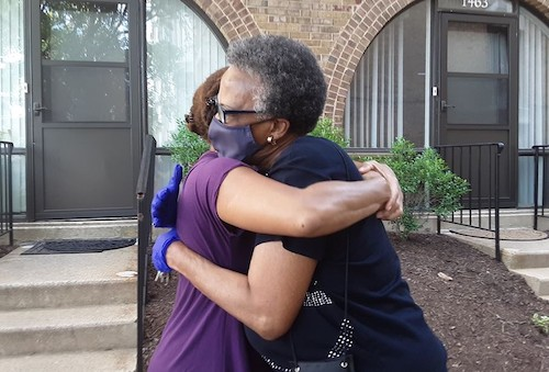 Anna Clark hugs her daughter-in-law after months of isolation and feelings of touch deprivation. (S. Sherman/The Washington Informer)