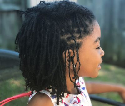 A young girl shows off her stylish locs. (Courtesy photo)