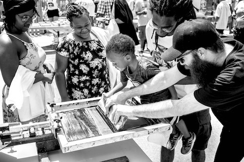 The arts non-profit, The Sanctuaries presented a poster-making workshop at the Anacostia Community Museum in December 2019. Image courtesy of The Sanctuaries.